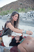 Woman holding owl claw during shamaic healing. Modern shamanic healer utilizing ancient technologies.