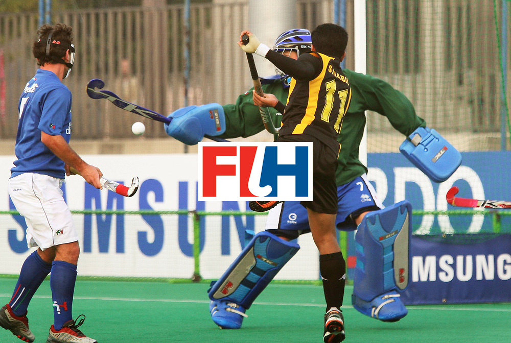Kakamigahara (Japan): Sharun Nabil of Malaysia who scored two goals tries to beat Italian goal keeper Marchi Alberto in the Olympic Hockey Qualifierat Gifu Perfectural Green Stadium at Kakamigahara on 06 April 2008.  <br /> Malaysia drew with Italy 4-4..  Photo: GNN/ Vino John