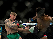 Charlie Ward (green shorts) in action against Galore Bofando during their welterweight bout during the UFC Fight Night at the SSE Hyrdo, Glasgow. PRESS ASSOCIATION Photo. Picture date: Sunday July 16, 2017. See PA story SPORT UFC. Photo credit should read: Craig Watson/PA Wire.