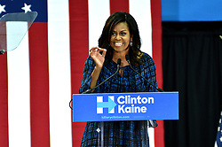 First Lady Michelle Obama stumps in support of Presidential democratic nominee Hillary Clinton and running-mate Tim Kaine, at a September 28, 2016 Voter Registration Rally at LaSalle University, in Philadelphia, Pennsylvania.