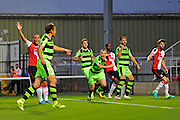 Forest Green midfielder Liam Noble (15) thinks he's scored during the Vanarama National League match between Woking and Forest Green Rovers at the Kingfield Stadium, Woking, United Kingdom on 16 August 2016. Photo by Jon Bromley.