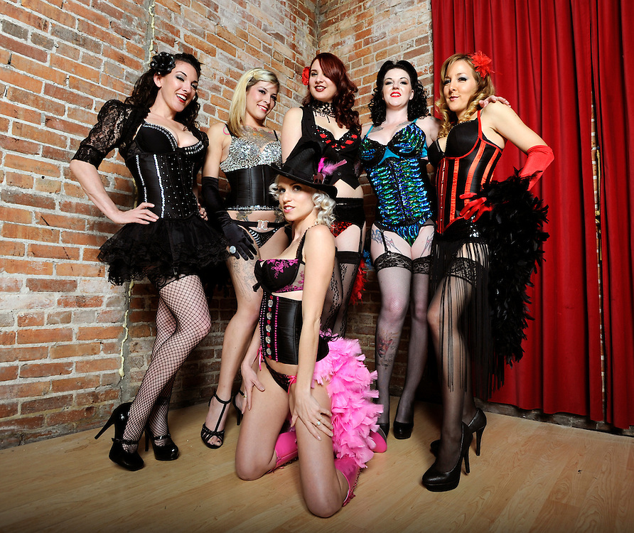Members of the Le Teaze Burlesque pose for a photograph Monday, Jan. 9, 2011 in Tampa. The troupe performs at various venues in the Tampa Bay area.