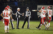 Kansas City Chiefs guard Mike McGlynn (75) points toward referee John Parry (132) and head linesman Derick Bowers (74) as they lobby for an offsides penalty during the NFL week 12 regular season football game against the Kansas City Chiefs on Thursday, Nov. 20, 2014 in Oakland, Calif. The Raiders won their first game of the season 24-20. ©Paul Anthony Spinelli