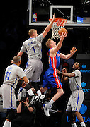 Brooklyn Nets' Paul Pierce (34), Mason Plumlee (1) and Joe Johnson (7) block the shot of Detroit Pistons' Kyle Singler (25)  during an NBA basketball game on Friday, April 4, 2014, in New York. (AP Photo/Kathy Kmonicek)