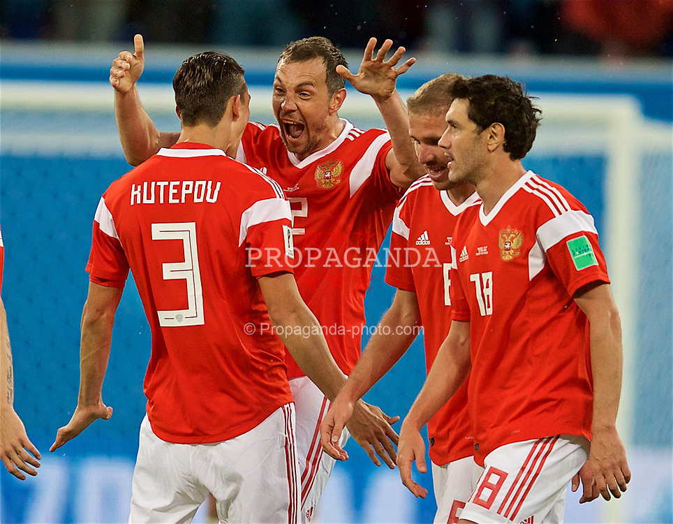 SAINT PETERSBURG, RUSSIA - Tuesday, June 19, 2018: Russia's Artem Dzyuba celebrates scoring the third goal with team-mate Ilya Kutepov during the FIFA World Cup Russia 2018 Group A match between Russia and Egypt at the Saint Petersburg Stadium. (Pic by David Rawcliffe/Propaganda)