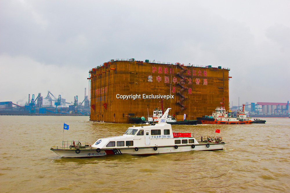 NANTONG, CHINA - JUNE 22: (CHINA OUT) <br /> <br /> The World's Largest Steel Open Caisson<br /> <br /> No. 28 steel open caisson gets transferred by tugboats on June 22, 2014 in Nantong, Jiangsu province of China. No. 28 steel open caisson, the world's largest steel open caisson with the weight of over 14,500 tons and the size of 86.9*58.7*44 meters, were transferred to the right place for construction in China's southeast city Nantong<br /> &copy;Exclusivepix