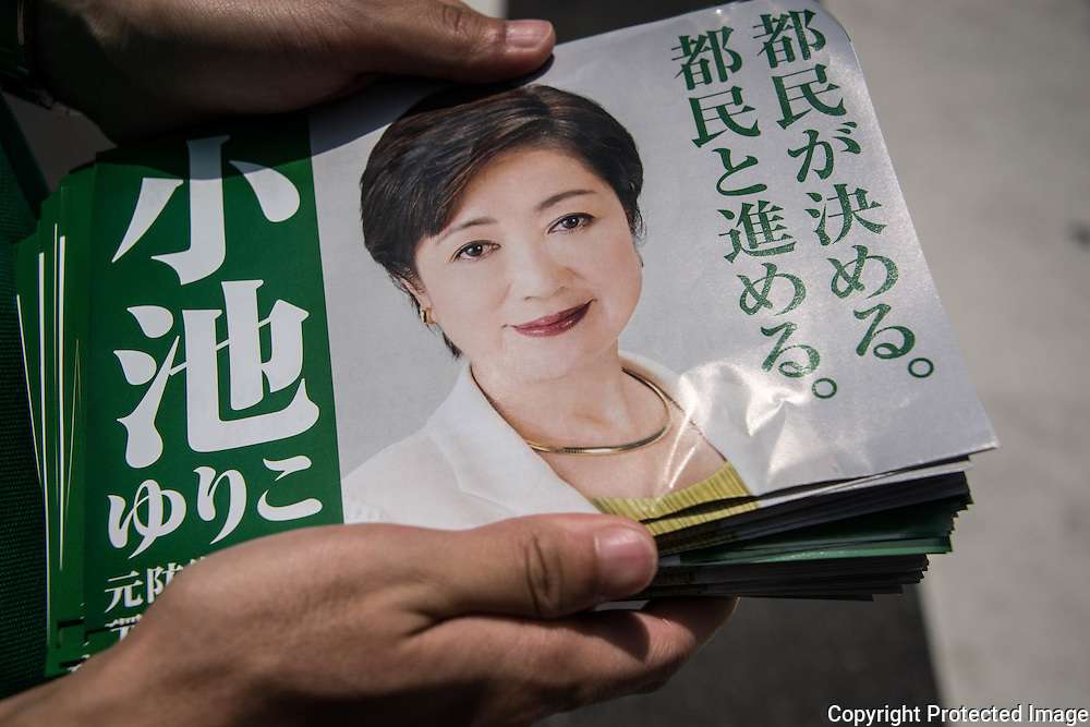 A campaign leaflets of Yuriko Koike, a Liberal Democratic Party lawmaker and former defense minister being distributed during the campaign for the July 31 Tokyo gubernatorial election in front of Meguro Station, Tokyo, Japan on Friday, July 29, 2016. 29/07/2016-Tokyo, JAPAN