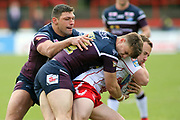 Leeds Rhinos winger Ryan Hall (5) helps to bring down a Hull Kingston Rovers player during the Betfred Super League match between Hull Kingston Rovers and Leeds Rhinos at the Lightstream Stadium, Hull, United Kingdom on 29 April 2018. Picture by Mick Atkins.