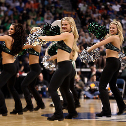 Mar 17, 2011; Tampa, FL, USA; Michigan State Spartans cheerleaders perfrom during the first half of the second round of the 2011 NCAA men's basketball tournament against the UCLA Bruins at the St. Pete Times Forum.  Mandatory Credit: Derick E. Hingle