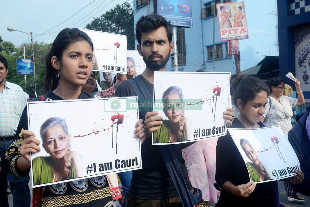 September 7, 2017 - Kolkata, West Bengal, India - Student Federation of India and Democratic Youth Federation of India members participate in a rally to protest against the killing of journalist Gouri Lankesh on September 7, 2017 in Kolkata. (Credit Image: © Saikat Paul/Pacific Press via ZUMA Wire)