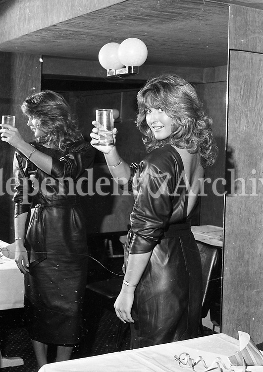 """Olivia Tracy """"Miss Ireland"""" at a farewell party in her honour in Rumours Night Club to wish her well as she leaves to repersent Ireland in the Miss World Contest in Albert Hall London, circa October 1984 (Part of the Independent Newspapers Ireland/NLI Collection)."""