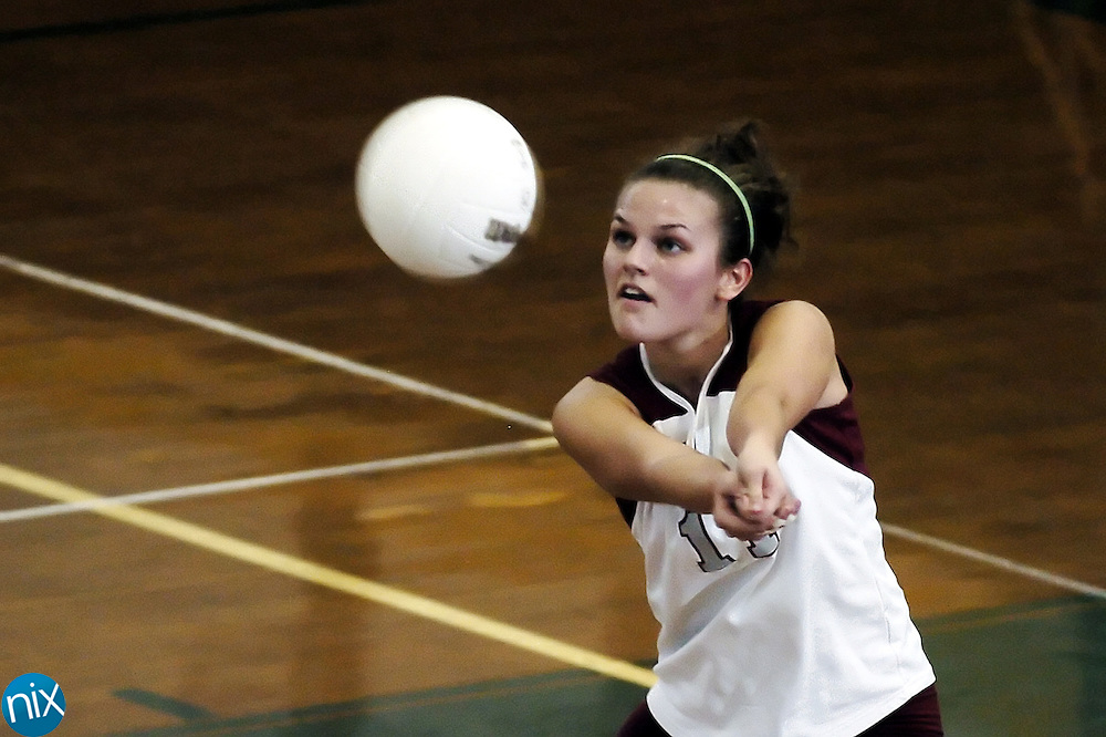 J. M. Robinson's Megan Wisehart returns the ball against Central Cabarrus Tuesday night.