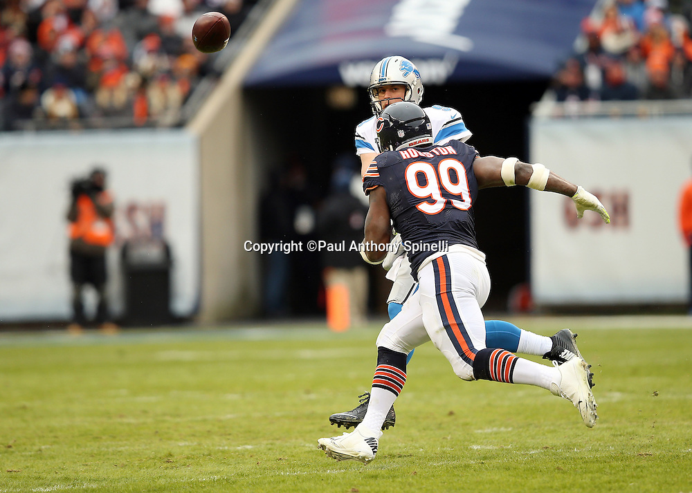 Chicago Bears linebacker Lamarr Houston (99) pressures Detroit Lions quarterback Matthew Stafford (9) on a pass play during the NFL week 17 regular season football game against the Detroit Lions on Sunday, Jan. 3, 2016 in Chicago. The Lions won the game 24-20. (©Paul Anthony Spinelli)