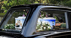 Pictured is the coffin with a portrait of Peaches Geldof and her family.<br /> Friends and family arrive at St Mary Magdalene and St Lawrence church in the village of Davington, Kent, to the funeral of Peaches Geldof.<br /> Monday, 21st April 2014. Picture by i-Images