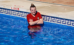 ALHAURÍN EL GRANDE, SPAIN - Tuesday, February 26, 2019: Wales Kylie Nolan cools off in the water of the hotel swimming pool during a training session at the at Alhaurin Golf Resort in Spain. (Pic by David Rawcliffe/Propaganda)