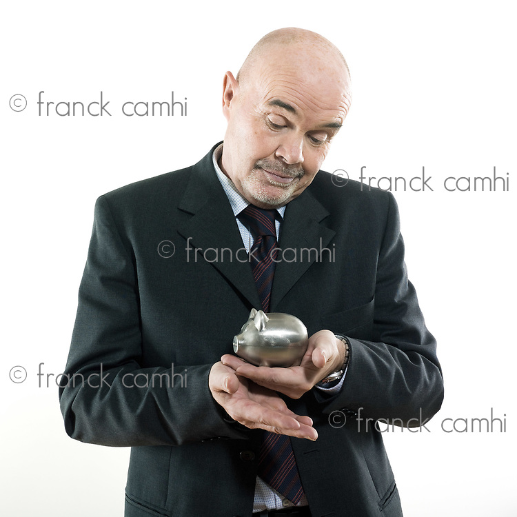 studio portrait isolated on white background of a man senior hoding a piggy bank