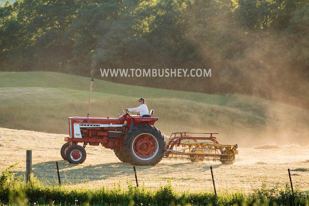 Mount Hope, New York - A farmer drives a tractor in a field at Pierson Farm on June 16, 2016.