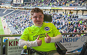 A young Albion fan (disabled) enjoys his first away game amongst a following of 7,000 Brighton supporters during the Sky Bet Championship match between Milton Keynes Dons and Brighton and Hove Albion at stadium:mk, Milton Keynes, England on 19 March 2016. Photo by Bennett Dean.