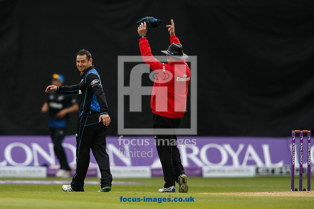 Nathan McCullum of New Zealand (left)  smiles after being hit for six by Eoin Morgan of England (not shown) during the Royal London One Day Series match at Edgbaston, Birmingham<br /> Picture by Andy Kearns/Focus Images Ltd 0781 864 4264<br /> 09/06/2015