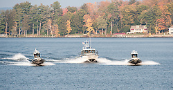 NH Marine Patrol's 41 footer, center, carrying the remains of Director David T. Barrett, is escorted through Weirs Bay for Barrett's memorial service aboard the MS Mount Washington on Monday, October 23, 2011.  (Alan MacRae/for the Laconia Daily Sun)
