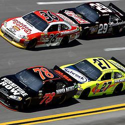 April 17, 2011; Talladega, AL, USA; NASCAR Sprint Cup Series driver Paul Menard (27) drafts Regan Smith (78) and Kevin Harvick (29) and Dave Blaney (36) during the Aarons 499 at Talladega Superspeedway.   Mandatory Credit: Derick E. Hingle