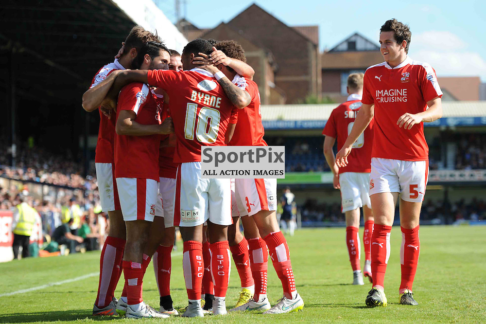 The Swindon players celebrate Fabien Robert opening the scoring in their Sky Bet League 1 clash with Southend