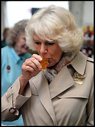 The Duchess of Cornwall judges the cider tasting competition as she  taste's Harry's cider in the Cider competition and declares Harry's cider the winner during a tour of the Royal Bath & West Show, Royal Bath & West Showground, Shepton Mallet, Somerset, United Kingdom, Wednesday, 28th May 2014. Picture by Andrew Parsons / i-Images