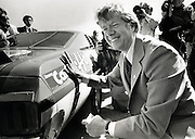 Jimmy Carter campaigns at at a NASCAR stock car race at the Atlanta International Speedway.