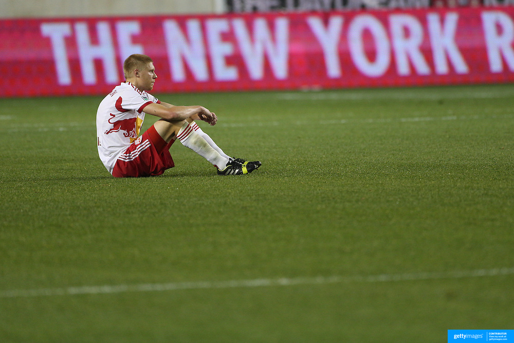 Markus Holgersson, New York Red Bulls, distraught at their sides loss after the final whistle during the New York Red Bulls V Houston Dynamo, Major League Soccer second leg of the Eastern Conference Semifinals match at Red Bull Arena, Harrison, New Jersey. USA. 6th November 2013. Photo Tim Clayton