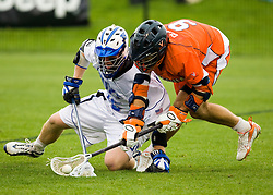 Virginia attackman Danny Glading (9) scoops up a loose ball in front of Duke defenseman Parker Mckee (35).  The #2 ranked Duke Blue Devils defeated the #3 ranked Virginia Cavaliers 11-9 in the finals of the Men's 2008 Atlantic Coast Conference tournament at the University of Virginia's Klockner Stadium in Charlottesville, VA on April 27, 2008.