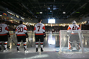 The RIT Men's Hockey team is introduced before a game against St. Lawrence University at the Gene Polisseni Center in Rochester, New York on Friday, October 10, 2014.