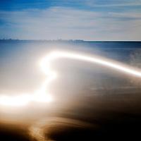 Light trail on a beach. Long exposure shot.