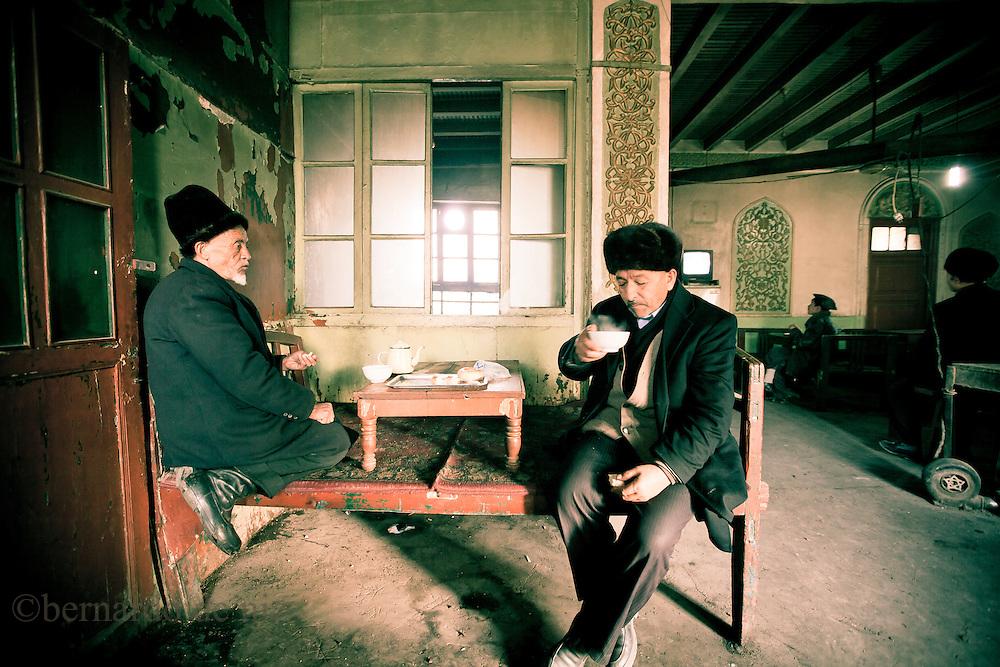 Uyghur  men drink Tea inside of a tea house in Kashgar oldest city, Xinjiang, on   February. 21, 2010. Photographer: Bernardo De Niz