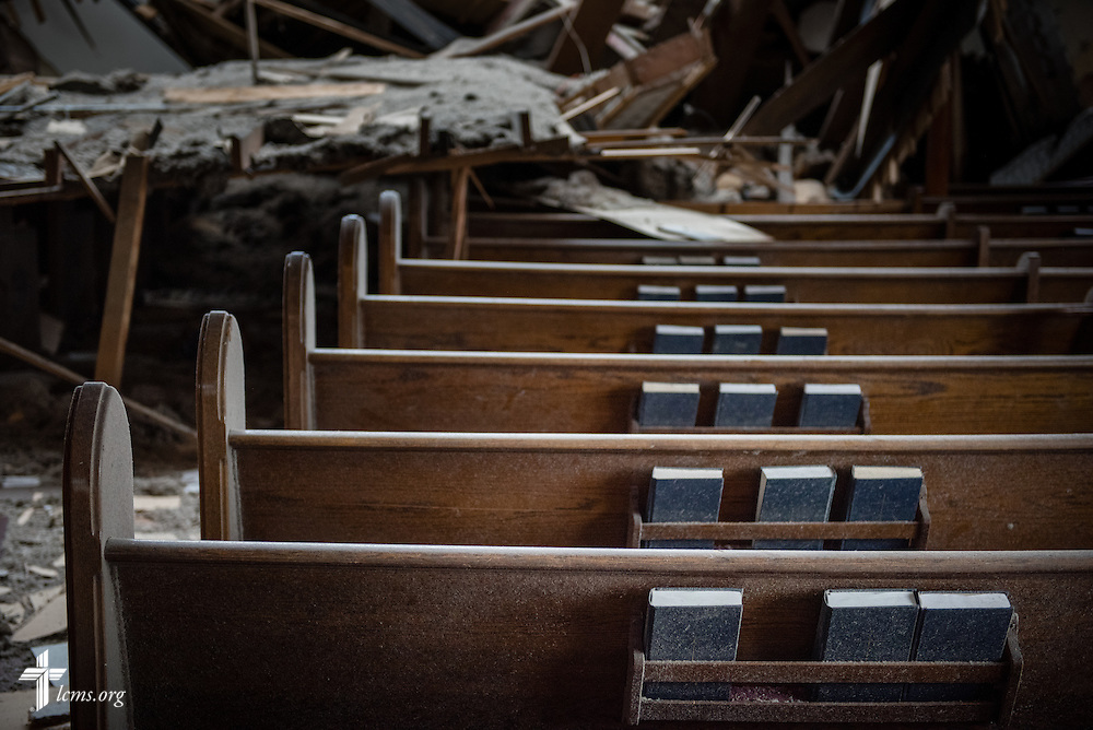 Hymnals lay in the pews amongst the rubble of Zion Lutheran Church on Monday, May 11, 2015, in Delmont, S.D. A tornado swept through the area the previous day and destroyed the church and nearby buildings. LCMS Communications/Erik M. Lunsford