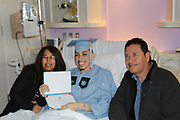 Madison HS senior Erick Reyes with his parents at Texas Children's Hospital.