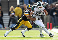November 12, 2011: Michigan State Spartans tight end Brian Linthicum (88) is hit by Iowa Hawkeyes cornerback Micah Hyde (18) during the first half of the NCAA football game between the Michigan State Spartans and the Iowa Hawkeyes at Kinnick Stadium in Iowa City, Iowa on Saturday, November 12, 2011. Michigan State defeated Iowa 37-21.