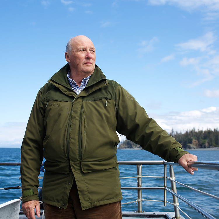 HOMER, ALASKA - MAY 26, 2015: His majesty King Harald V of Norway on the deck of the Rainbow Connection on his way back to Homer, Alaska from Tutka Bay Lodge durring his tour of Alaska.