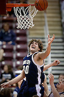 JEROME A. POLLOS/Press..Wes Beusan from Lake City High jumps above players from Rocky Mountain High as he goes up for a rebound.