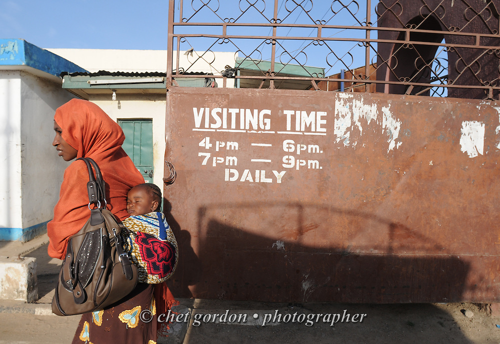 Nigerian woman and child enters a wing of the Murtala Muhammad Specialist Hospital in Kano, Nigeria on Wednesday, December 5, 2012.