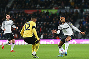 Derby County defender Max Lowe (25) takes on Millwall defender Mahlon Romeo (12) during the EFL Sky Bet Championship match between Derby County and Millwall at the Pride Park, Derby, England on 14 December 2019.