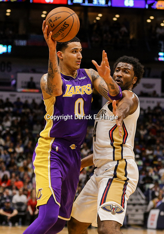 Mar 22, 2018; New Orleans, LA, USA; Los Angeles Lakers forward Kyle Kuzma (0) is defended by New Orleans Pelicans forward Solomon Hill (44) during the second quarter at the Smoothie King Center. Mandatory Credit: Derick E. Hingle-USA TODAY Sports