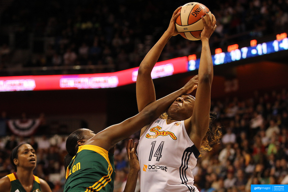 Kelsey Bone, (right), Connecticut Sun, is hit hard by Shekinna Stricklen, Seattle Storm, as she drives to the basket during the Connecticut Sun Vs Seattle Storm WNBA regular season game at Mohegan Sun Arena, Uncasville, Connecticut, USA. 23rd May 2014. Photo Tim Clayton