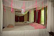 Beds in guest dormitory at Bulou's Eco Lodge, Navala Village, Viti Levu Island, Fiji.