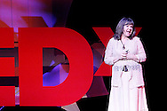 Nora Stanger speaks during TEDx Dayton at the Victoria Theatre in downtown Dayton, Friday, November 15, 2013.  TEDx Dayton is a localized version, and uses a format similar to national TED (Technology, Entertainment, Design) events.