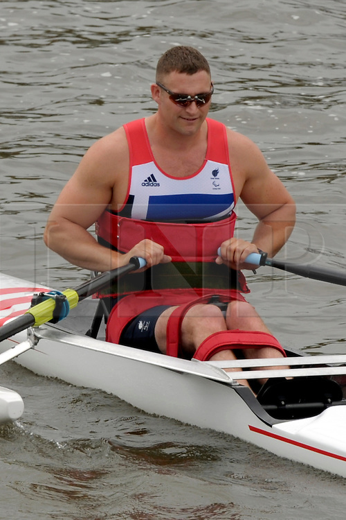 © Licensed to London News Pictures. 27/06/2012. Henley-on-Thames, UK Tom Aggar. Great Britain's rowing team for the London 2012 Paralympics was announced during Wednesday's lunch interval and the four crews rowed down the Henley course through the enclosures. Henley Royal Regatta on June 26, 2012 in Henley-on-Thames, England. The 172-year-old rowing regatta is held 27th June- 1st July 2012. Photo credit : Stephen Simpson/LNP