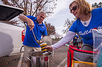 Mike and Michelle McMurtrey of Folsom serve up gumbo in the parking lot to tailgaters from Folsom before the start of the Sac-Joaquin Section Division I championship game between the Folsom Bulldogs and the St. Marys Rams at Hornet Stadium at Sacramento State, Saturday Dec 2, 2017. The couple started the tradition during the 2010 State championship game when Folsom played.<br /> photo by Brian Baer