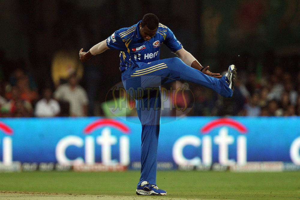 Kieron Pollard angry after bowling a wide during match 62 of the the Indian Premier League ( IPL) 2012  between The Royal Challengers Bangalore and the Mumbai Indians held at the M. Chinnaswamy Stadium, Bengaluru on the 14th May 2012..Photo by Jacques Rossouw/IPL/SPORTZPICS