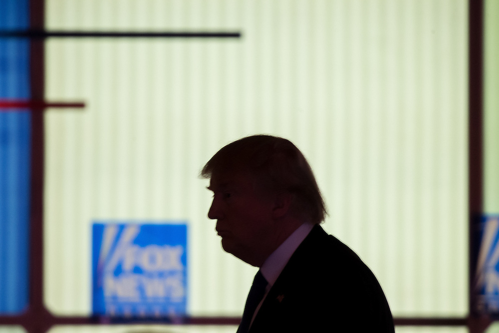 Republican Presidential candidate  Donald Trump walks across the stage during a break in the Republican Presidential Debate in Detroit, Michigan, March 3, 2016.<br /> AFP PHOTO/Geoff Robins