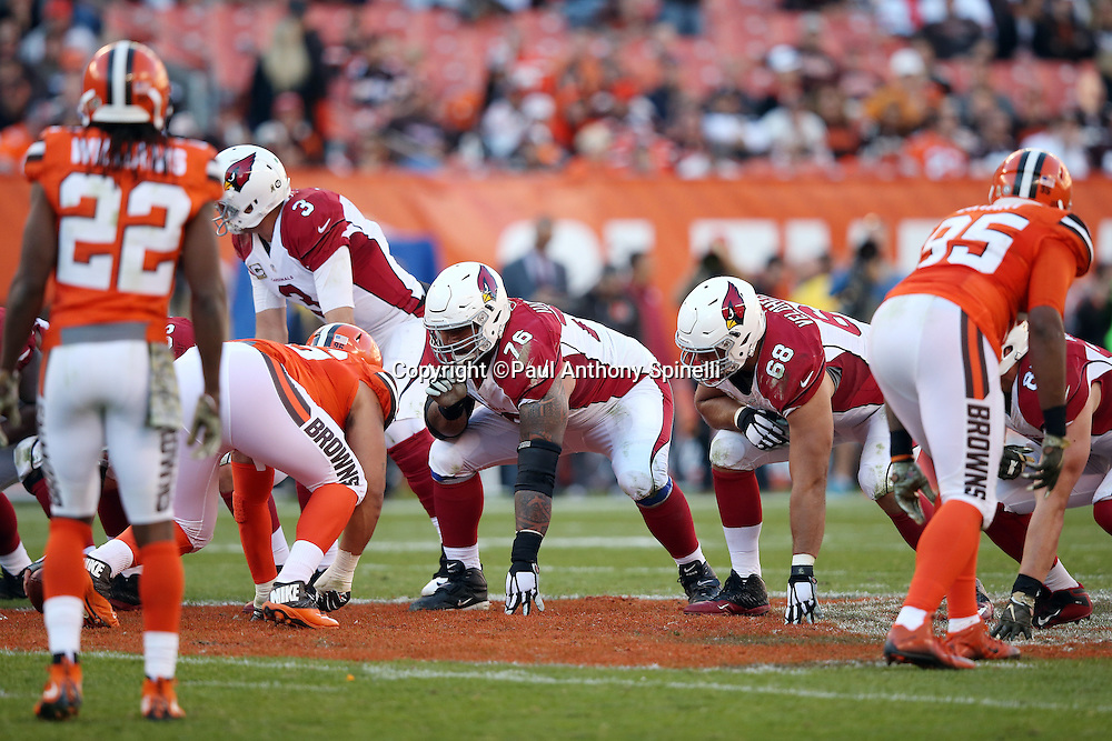 Arizona Cardinals guard Mike Iupati (76) and Arizona Cardinals tackle Jared Veldheer (68) get set at the line of scrimmage during the 2015 week 8 regular season NFL football game against the Cleveland Browns on Sunday, Nov. 1, 2015 in Cleveland. The Cardinals won the game 34-20. (©Paul Anthony Spinelli)