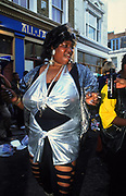Woman dancing in the street Notting Hill Carnival London 1997